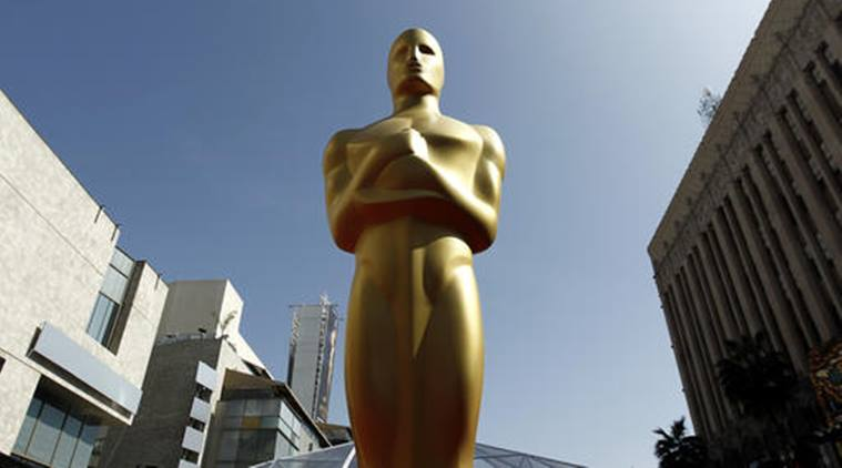 FILE - This Feb. 26, 2012 file photo shows an Oscar statue on the red carpet before the 84th Academy Awards in Los Angeles. Nominees for the 89th Academy Awards will be announced on Tuesday, Jan. 24, 2017.. (AP Photo/Matt Sayles, File)